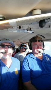 Scott Langston, Chris Lawrence and Scott Saunders fly supplies to Bahamas